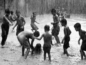 Children playing in rain